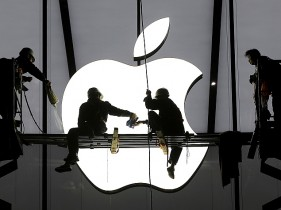 workers_apple_logo_building_reuters